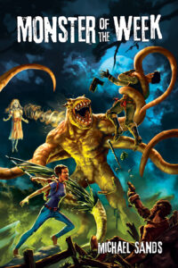 The cover says Monster of the Week across the top in white text that looks like it's degrading. There is a bipedal green monster with huge jaws and four tentacles instead of arms in the middle. It is fighting off four humans. On the left is a girl in a dress floating in the sky and firing a beam from her mouth. Below her is a woman in jeans and a t-shirt who is slashing one of the tentacles with a sword. To her right, in the bottom corner, is a man who has fallen to the ground. He is firing a pistol at the monster. In the top right is another man who is wrapped in a tentacle. He's wearing tactical gear and his gun is falling out of his hands.